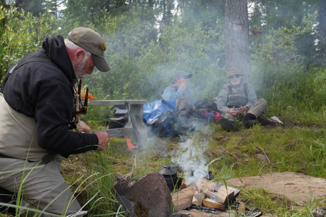 Cowboy Coffee Against an Ancient Tamarack